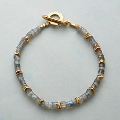 "THROUGH SMOKE BRACELET -- Labradorite barrel beads shimmer on our bracelet in smoky blues, grays and greens while wavy 18kt gold vermeil disks and brass accent beads gleam. Yellow bronze toggle. USA. Exclusive. 7-3/4""L."
