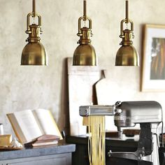 petite pendant lamps.  Yoke Pendant Lamps with Brass shades from Williams Sonoma.  $295 each