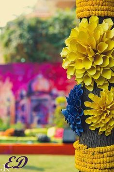 paper flowers, artificial florals, outdoor decor, yellow and blue