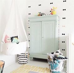 White nursery with pastel touches and black accents.