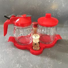 This vintage sugar creamer set includes wood salt and pepper shakers and a red plastic tray. The set will add a great vintage touch to your kitchen and will work well with fiesta ware or other vintage pieces. In good condition with just a bit of wear to the paint on the salt and pepper Vintage Kitchenware, Vintage Glassware, Vintage Pyrex, Logan House, Childrens Shop, Plastic Trays, Kitchen Items, Kitchen Gadgets, Mid Century Modern Decor