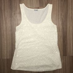 Crochet & Sequence Tank Top This tank top is from Express and is a size small. The front is white crochet material with clear sequence to add subtle sparkle! The back is flowy, light cotton material. Express Tops Tank Tops
