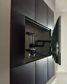 ability to adjust the viewing angle... To provide this accessibility, the television is mounted on an adjustable arm that is hidden when the television is pushed back flush with the wall.