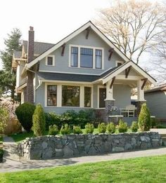 <3 I'd Love to add that little porch to the front of my house & I Love the stone wall instead of the cement wall I have
