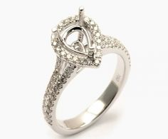 White gold pear cut halo semi-mount engagement ring with diamond accented split band. Center diamond sold seperately. Also available in yellow and rose gold. Metal:Eighteen Karat Gold Diamond Weight:.39 Carats Designer:Diadori $ 2,375.00 Item #: 0P73KF Call 870-863-8818 for personal consultation.
