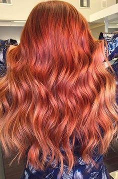 Would you try this fiery red hair color for spring? Get the look using using Wella Color Touch 7/43 and Color Touch Relights /43 with 13 volume for the base. Then, balayage using Wella Freelights with 40 volume, Color Touch 9/3, and Koleston Perfect /33 with 6 volume.