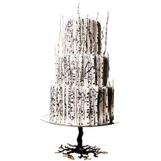 STYLE INSPIRATION: SNOW WHITE & THE HUNTSMAN  Fondant and white-chocolate branches cake, $15 per serving (serves 75), Lulu Cake Boutique. Cake stand, $295, L'Objet.