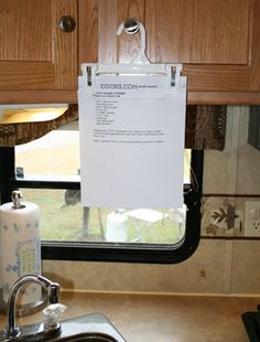 Perfect RV Recipe Holder. Why didn't I think of that? For more information on camping fun for the whole family visit hartranchresort.com. #camping #RV #BlackHills