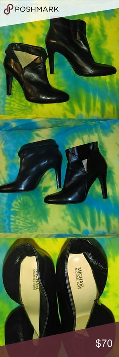 "Michael Kors Fold-Over Top Ankle Booties Boots 9.5 Here's an adorable pair of Michael Kors ankle boots.  They have a 4"" heel.  They're 100% leather in the uppers and the soles. That's why the soles look so rough; I would have cleaned/conditioned them like I did the uppers but I was worried it would make them slick/slippery.  These honestly have minimal wear with no scratches or gouges. You can wear them with the foldover up or down.  I showed them both ways.  Thanks for looking, sorry no…"