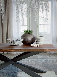 Table with base in matte white or matte graphite varnished steel, stainless steel, or canaletto walnut. Top in walnut canaletto with natural solid wood edges.