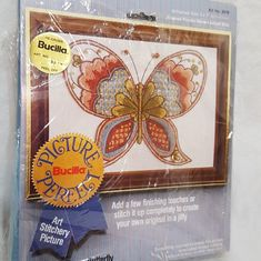 Model: Crewel kit to make a butterfly. Six-strand Cotton Floss and/or Rayon Thread and/or Persian Crewel Wool. Condition: New, kit is complete. The plastic cover has ripped open in a few places.