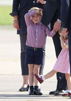Catherine, Duchess of Cambridge wore a lavender dress from Emilia Wickstead with a flared skirt, paired with a small red clutch, as she an...