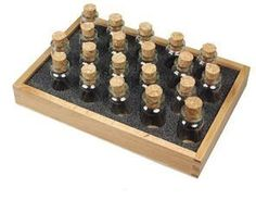 24 Glass Corked Bottles For Bead Storage with Wood Tray. $6.99, via Etsy. plus $8 ship