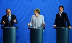 Francois Hollande, Angela Merkel and Matteo Renzi address a press conference in Berlin on Tuesday.