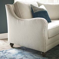 Marseille Conversation Sofa by Bassett Furniture features nail head accents that highlight the fabric gimp treatment.