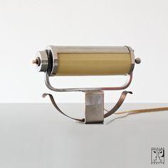 Bauhaus clamp light. 1935  (Germany)  chrome-plated brass, opal glass