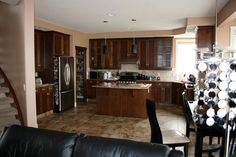 Open Concept - Nice open concept kitchen with sufficient counter-top, an angled sink and ease of access to all cabinets.