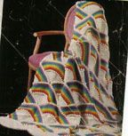 There is something so appealing about the structure of this afghan. I am thinking self striping yarn or even solid color with just one stripe at the top of the rainbow arch. Rainbow Afghan Pattern | Craftingrannys Craft & Sewing Room
