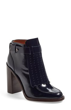 Free shipping and returns on Tory Burch 'Hyde' Bootie (Women) at Nordstrom.com. A perforated, kiltie-inspired cuff adds timeless sophistication to a standout stacked-heel bootie shaped from high-shine leather.