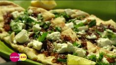 Barbecued flatbreads with onion and feta