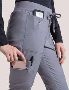 10 Pocket Cargo Pant in Graphite is a contemporary addition to women's medical scrub outfits. Shop Jaanuu for scrubs, lab coats and other medical apparel. Dental Uniforms, Work Uniforms, Scrubs Outfit, Scrubs Uniform, Stylish Scrubs, Cute Scrubs, Black Scrubs, Medical Scrubs, Female Doctor