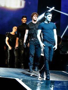 """Tom: """"You know I'm working it!""""  Jay: """"I'm not gonna fall, I'm not gonna fall..""""  Siva: """"Grinning and bearing it. and also loving it""""  Max: """"I think that girl was on the front row at the last gig..."""""""