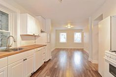 This 1-bedroom apartment in Lakeview has a spacious kitchen kitchen with butcher block counters, lots of cabinet space, and a dishwasher and opens to a bright living area with new hardwood floors.