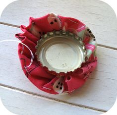 Covering bottle caps with yo-yos and then sewing them together as a trivet. Hmmm. What else could they become?