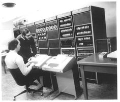 UNIX inventors Ken Thompson and Dennis Ritchie at Bell Labs before a DEC PDP-11 minicomputer