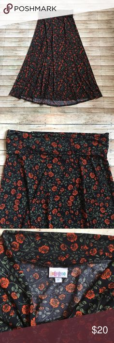 Medium LuLa Roe Floral MAXI Medium LuLa Roe Floral MAXI. Black with dark orange flowers and green leaves. Looks great paired with a tank top! Silk material: 96% polyester, 4% spandex. Machine wash, hang dry. Worn twice. 10% discount when you bundle 2 or more items from my closet! LuLaRoe Skirts Maxi