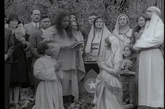 """A still image from the short movie filmed in Los Angeles, January 23, 1931, at Mt. Washington. Here Swami #Yogananda is marrying  Brahmacharee Nerode and Agnes Spenser. """"This marriage is symbolical of breaking down the barriers of the brown Caucasians of India, and the white caucasians of America,"""" the Master said. It was still illegal for mixed race couples to marry in California in 1931.The gentlemen in the White Robe is Hamid Bey. In the background is a young Durga Mata."""