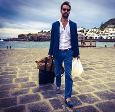 """Antonio Rummo while leaving the island of Panarea wearing #CbAmalfi canvas straight cut slip-ons and carring beside his luggage also """"Arancini"""" for the trip..."""