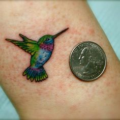 tiny color hummingbird tattoo. Maybe just an outline like the bluebird