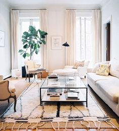 Ideas to steal: layered rugs and a leggy/visually light coffee table