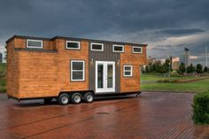 This is the 28′ Freedom Tiny House on Wheels. It's built by Alabama Tiny Homes on a tri-axle utility trailer. This tiny is located in Birmingham, Alabama. Currently it's for sale,…
