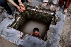 Muhammed Muheisen—AP  April 10, 2012. A Pakistani boy swims in a water reservoir to cool off as the temperature rises, while others wait their turn, next to a slum area on the outskirts of Islamabad.