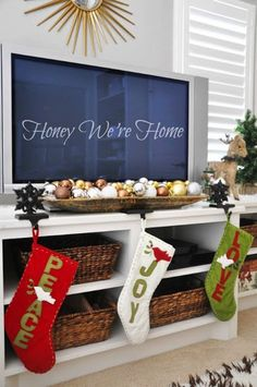 Dress up your media center for the holidays with your Christmas stockings.