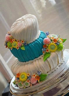 Photo about Blue and white fondant wedding cake with colorful floral decoration. Image of bakery, wedding, flowers - 24433137 Cake Stock, Fondant Wedding Cakes, Photo Blue, Image Photography, Bakery, Blue And White, Floral, Cake Pictures