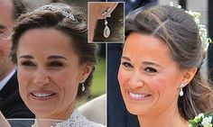 Pippa Middleton, 33, appeared to follow tradition and wore a pair of diamond drop earrings as the 'something old' to bring her good luck as she tied the knot in Berkshire yesterday.