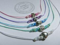 5 zarte pastellfarbene Armbänder für den Kindergeburtstag als Gastgeschenk