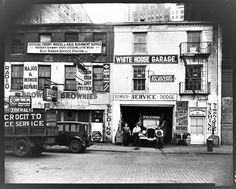 Walker Evans [Brownie's and White House Garage Shopfronts with Palumbo Fuel Truck and Workers Posing, New York City 1934 ... @WalkerEvansArchives