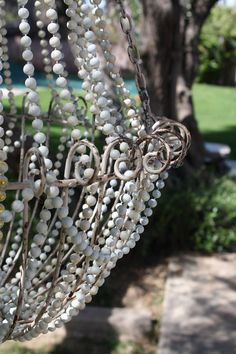 After shopping for a vintage looking beaded French Country chandelier, and seeing the astronomical cost of these beauties, I quickly decided. Outdoor Chandelier, Beaded Chandelier, Chandelier Lighting, Homemade Chandelier, French Country Chandelier, Chandelier Makeover, Style Shabby Chic, Braided Rag Rugs, Basket Lighting