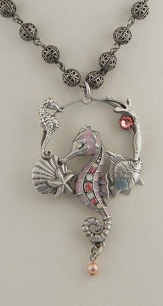 """Seahorse Hoop Necklace made with shades of vintage rose and white opal Swarovski Crystals, and cabochons in pink mussel and mabe pearl. 18"""" long. Made with American Lead Free Pewter. Please allow 2-4"""