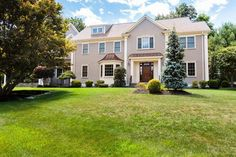 Stunning center entrance Colonial beautifully sited in sought after neighborhood offers exquisite craftsmanship throughout. Elegant foyer opens to lovely living room and formal dining room with wood inlay hardwood floors and picture windows. Gourmet Chef's kitchen features center island, double ovens, wine chiller and sun-filled eat in area with exterior access to patio and level, lushly landscaped grounds. Bright and inviting family room with custom built-ins, fireplace and French doors…