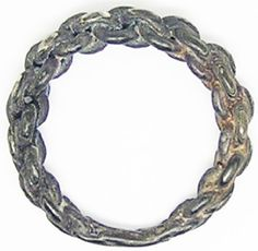 This is a fabulous ancient Scandinavian Viking silver finger ring, dating to the 9th - 11th century A.D. The ring is formed from graduated rods of silver knotted together, the terminals welded to form a complete round ring. This example is typical of the elaborate skills of the Viking age jeweller, of a complex yet iconic design of ring (see here) first introduced to Britain and Ireland during the 10th century. This example recovered during dredging work, is intact and of good stable silver