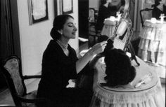 Maria Callas brushing her poodle Toy