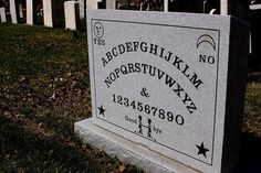 This is Elijah Bond's gravesite marker. He patented and trademarked the world's first commercially sold Ouija Board, which he trademarked as the Nirvana Board. It immediately captured people's imaginations with his claims that it could help one speak to people from beyond the grave.
