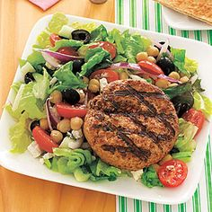 Lamb Burgers with Greek Salad i use turkey burgers,  this salad is soo good, the dressing is very simple, but tasty