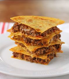 These Bacon BBQ Cheeseburger Quesadillas are a quick and easy weeknight meal or a perfect football party snack. Meaty, saucy and cheesy for under 300 calories or just 8 Weight Watchers points! www.emilybites.com