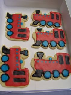 Special train engine sugar cookies for a little boy's 2nd birthday party. There were also round sugar cookies with white icing, a perimeter red circle, and a red number 2.